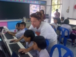Linda showing kids new computers